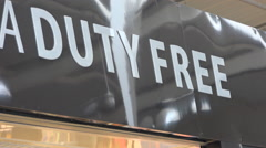 Duty free aera full of travellers shoppers - Beauvais airport, France - Zoom out Stock Footage