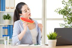 this summer is extremely hot, you need to eat watermelon - stock photo