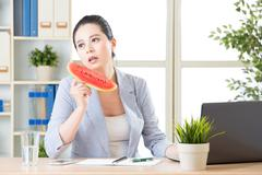 if you feel hot in office try watermelon for reduce temperature - stock photo