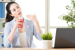 hot weather in office, you must try watermelon juice reduce body temperature - stock photo