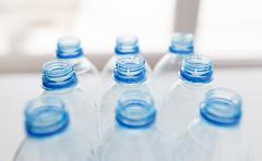 close up of empty used plastic bottles on table - stock photo
