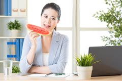 She's always available for business, reduce the summer heat - stock photo