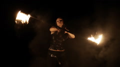 Fire dance performer show with burning fire on black background Stock Footage