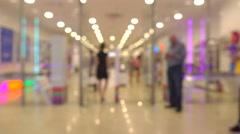 Unrecognizable customers walking in modern shopping mall. 4K bokeh shot Stock Footage