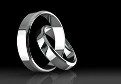Closeup of Platinum wedding bands on a black background. Stock Illustration