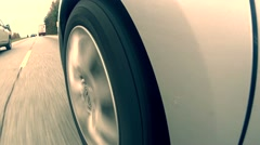 POV of Car Tire Driving Down Highway Stock Footage