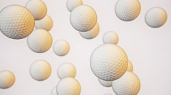 Floating Golf Balls Against White Stock Footage