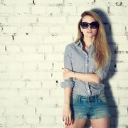 Street Style Fashion Girl at Brick Wall Stock Photos