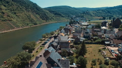 Flying over a small town along the Moselle River in Germany Stock Footage