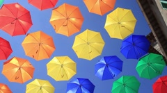 Colourful umbrellas urban street decoration Stock Footage