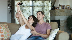 Charming marriage or couple laughing and taking a selfie with phone sitting on a Stock Footage