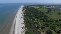 Aerial flyby of a barrier island on the edge of the Atlantic Ocean Stock Footage