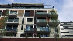 Modern multi-storey house with windows and balconies Stock Footage