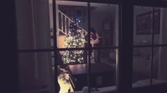 Family Decorating Christmas Tree At Night In Living Room - stock footage