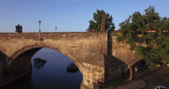 Aerial camera rises up the side of the Charles Bridge - stock footage