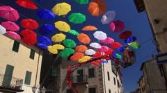 Colourful umbrellas urban street decoration Stock Footage