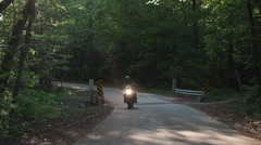 Man Riding Motorcycle on Rural Country Road Stock Footage