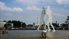 Timelapse of Molecule Men statue in the river Spree, Berlin Stock Footage