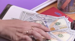 Woman accountant with money - stock footage
