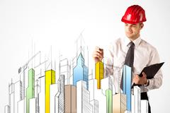 Business person sketching a city sight - stock photo