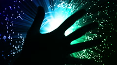 Hand full of brightly lit fiber optic cables Stock Footage