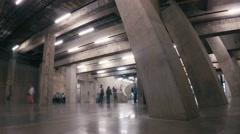Timelapse of tourists exploring the basement of the Tate Modern Gallery Stock Footage