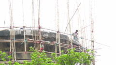 Labours demolishing concrete structure, Howrah, West Bengal, India. Stock Footage