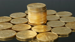 Single tower of US Mint gold coins rotating Stock Footage
