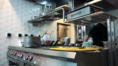 Cook in kitchen in restaurant prepares a food Stock Footage