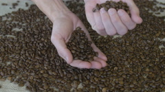 Man holding coffee beans Stock Footage