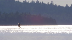 Wakeboarder being pulled behind Personal Watercraft Extreme Sports - stock footage