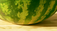 Big green and ripe watermelon in the rays of a bright summer sun Stock Footage