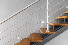 Simple staircase with chromed railing idea Stock Photos