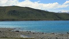 New Zealand Lake Tekapo mountains beyond pan Stock Footage