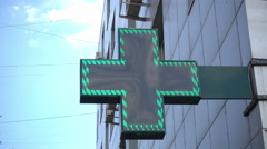 Illuminated pharmacy sign Stock Footage