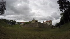 Timelapse of clouds floating above the old castle Stock Footage