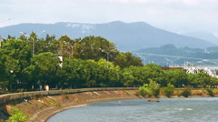 Waterfront area of the mountain river Mzymta located near the mountain range  Stock Footage
