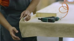 Close up on hands of furniture maker on manufacture Stock Footage