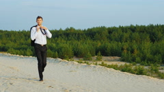 Free and happy man. Businessman happily moving forward, weakens tie and smiling Stock Footage