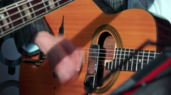 Men play on guitar - close up hands with guitar Stock Footage