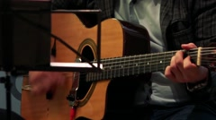 Man sits and plays on guitar - close up guitar Stock Footage