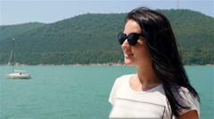 Portrait of Beautiful Girl In Sunglasses On a Background of Mountains And The Stock Footage
