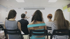 group of people listening to a presentation at a business seminar - stock footage