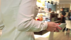 Waitress holds a bowl and two plates with cakes and takes it away Stock Footage