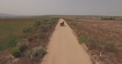 Tourists riding motor bike on the dirt road Stock Footage