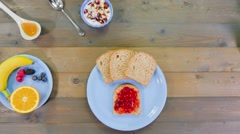Top view of man having breakfast animation stop motion Stock Footage
