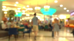 People eating fast food in mall food court. 4K bokeh shot Stock Footage
