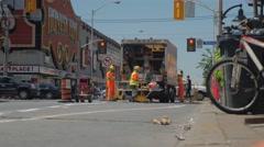 Honest Eds Construction Workers Installing Bike Lanes Bathurst Bloor Stock Footage