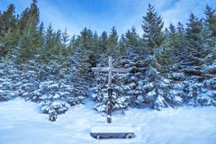 Wooden cross in winter scenery Stock Photos