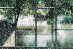 Wet window in drops during the summer rain Kuvituskuvat